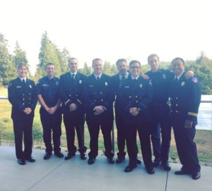 From left to right: Newly-hired Firefighter Janelle Randles, Intern Firefighter Scott Bothe, Lieutenant Alex Hickey, Firefighter/Paramedic Craig Barnard, newly-promoted Assistant Chief Sean Moran, newly-hired Firefighter Kaleb Murray, Intern Firefighter Tyler Horner and newly-promoted Battalion Chief Ardyl Abrigo